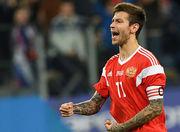 Смолов поставил сердечко между флагами России и Украины на фото с Шевченко
