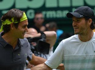 Федерер и Хаас уступили в парном разряде на турнире в Галле