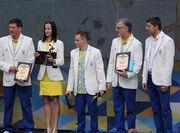 Наталья Прищепа и Олег Верняев получили награды НОК